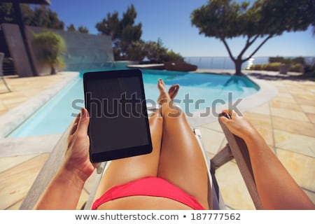 woman in bikini with tablet pc computer Stock photo © dolgachov
