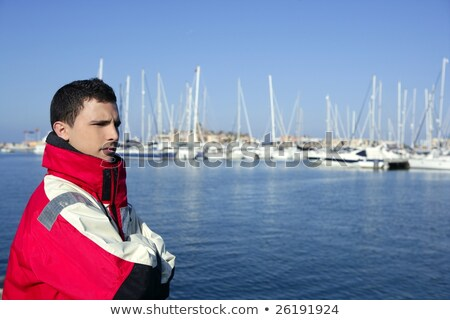 handsome boy on harbor with red marine coat stock photo © lunamarina