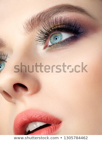 woman with extreme colorfull make up in blue and yellow Stock photo © juniart