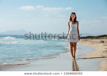 brunette woman standing on beach stock photo © chesterf