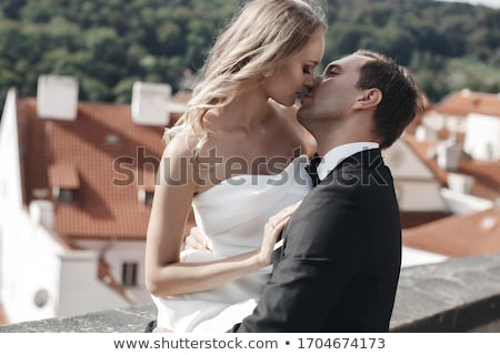 happy bridal couple in park stock photo © chesterf