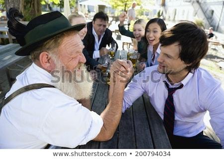 senior in traditional bavarian clothes in beergarden stock photo © kzenon