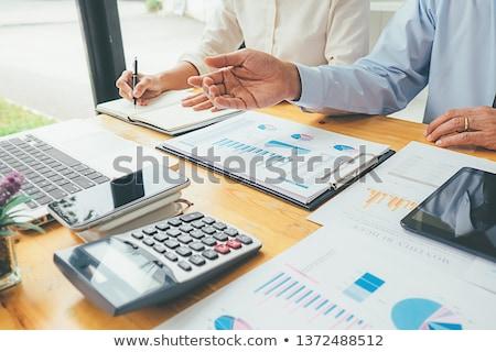 üzletember · megvizsgál · iratok · fiatal · felnőtt · bent · üzlet - stock fotó © diego_cervo