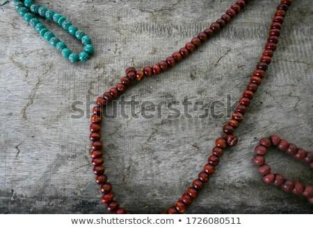 Rózsafüzér fából készült felület közelkép kék istentisztelet Stock fotó © bdspn