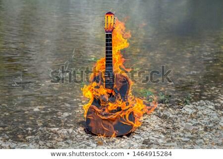 Guitarra acústica fuego llama negro música guitarra Foto stock © m_pavlov