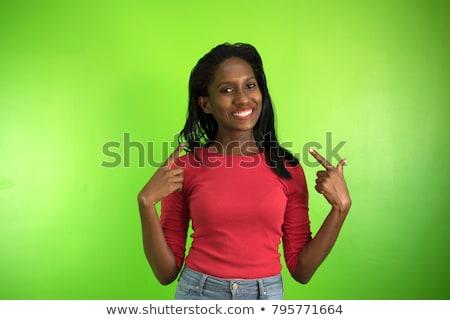 mulher · indicação · mulher · jovem · verde · olhando - foto stock © bmonteny