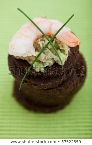 Delicious appetizer of a prawn on a bed guacamole Stock photo © raphotos