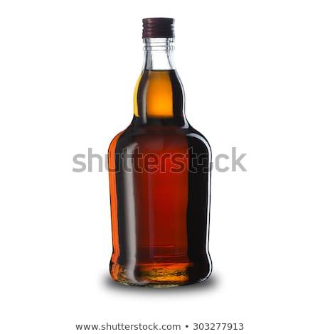 Bottiglie rum cubetto di ghiaccio come cristallo Foto d'archivio © tarczas