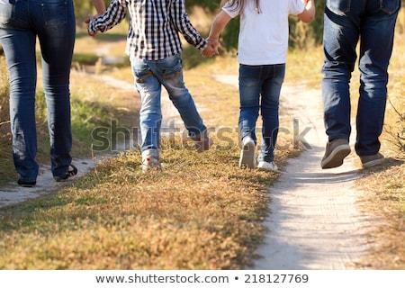 семьи ног джинсов трава матери зеленый Сток-фото © koca777