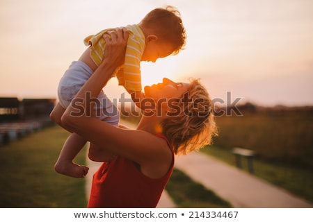 silhouette of a young mother with her little child stock photo © konradbak