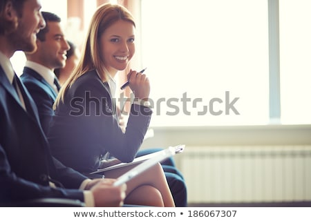 Business people sitting in a row and working Stock photo © HASLOO