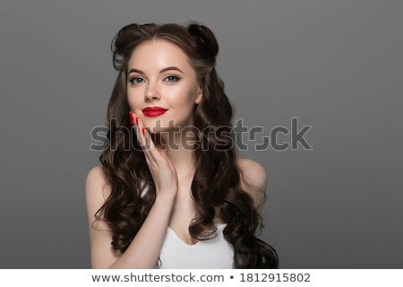 Red hair girl in pin-up style portrait shot in studio Stock photo © jeancliclac