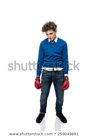 Full length portrait of a defeated young business man over white background Stock photo © deandrobot