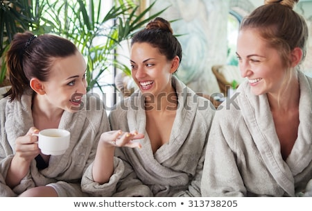 Three young women drinking tea at spa resort Stock photo © dashapetrenko