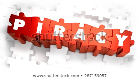 Piracy - White Word on Red Puzzles. Stock photo © tashatuvango