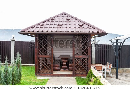 Tiled Roof Of Wooden Arbor Stock photo © bubutu