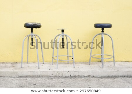 Broke one middle of two perfect high bar stool. Stock photo © art9858