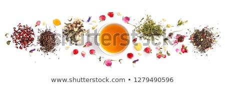 üveg csésze tea citrom virágok izolált Stock fotó © tetkoren