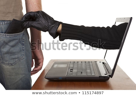 Stock photo: Person Hand Reaching Out From A Laptop Grabbing Wallet