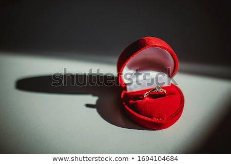 Wedding rings in red box isolated on white Stock photo © tetkoren