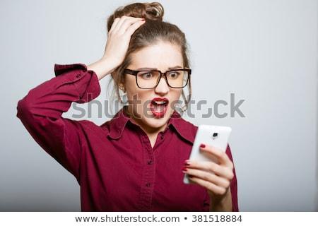 Imprenditrice parlando cellulare guardando sorpreso business Foto d'archivio © imagedb