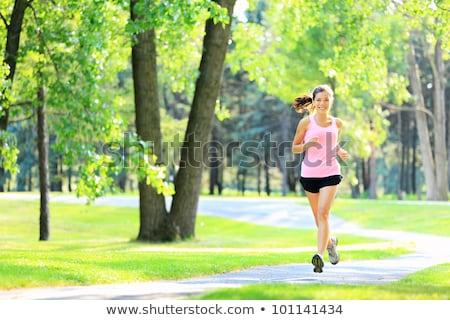 Woman runner jogging in city park Stock photo © Maridav