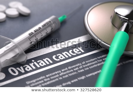 Ovarian cancer - Printed Diagnosis on Grey Background. Stock photo © tashatuvango