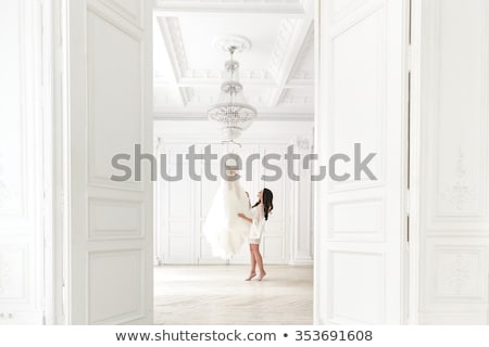 Stock photo: Pretty lady in light charming dress isolated on white