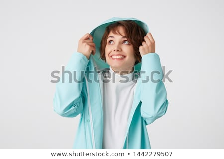 cute smiling girl in light short coat isolated on white stock photo © elnur