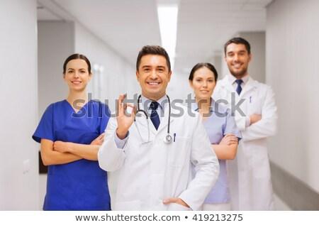 uśmiechnięty · lekarza · biały · płaszcz - zdjęcia stock © dolgachov