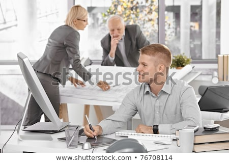 Tablet computer and paper with blueprints  Stock photo © deandrobot