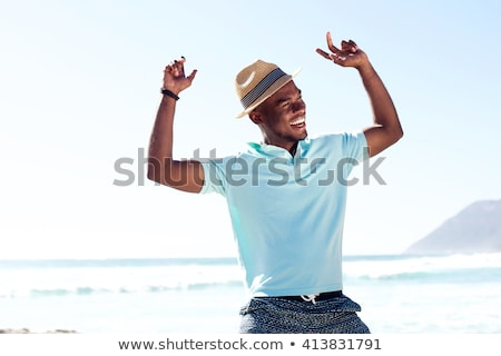 handsome black man dancing with excitement Stock photo © zdenkam
