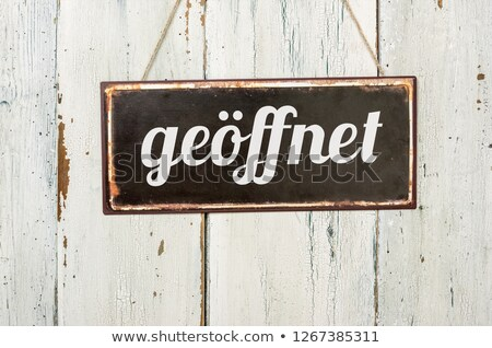 old metal sign in front of a white wooden wall   entrance stock photo © zerbor