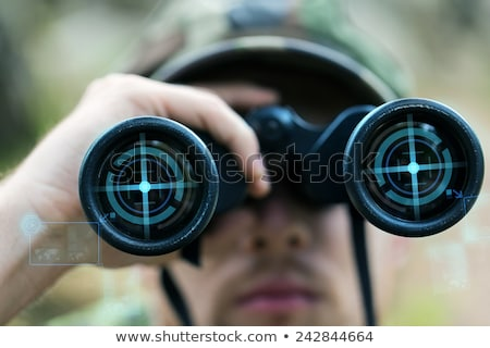 Stok fotoğraf: Close Up Of Soldier Or Hunter With Binocular