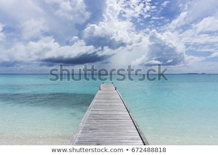 Blauw zee houten pier ondiep Stockfoto © artfotodima