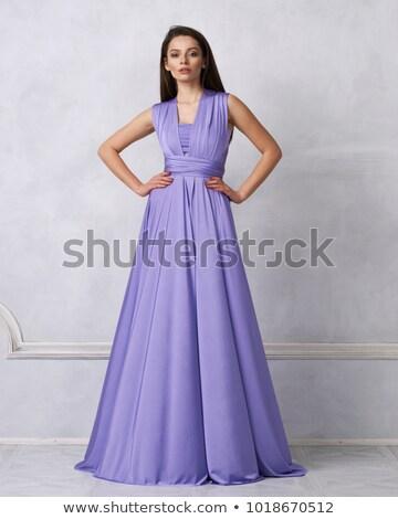 A woman wearing a blue sleeveless dress Stock photo © bluering
