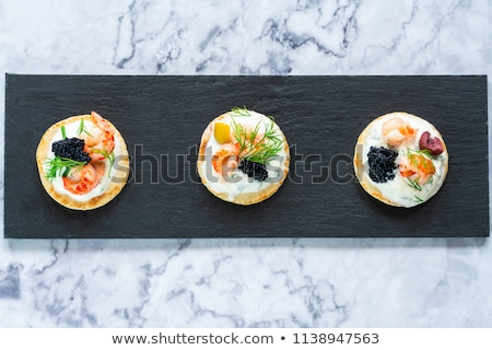 Smoked Salmon Canapes with Sour Cream and Caviar Stock photo © Klinker