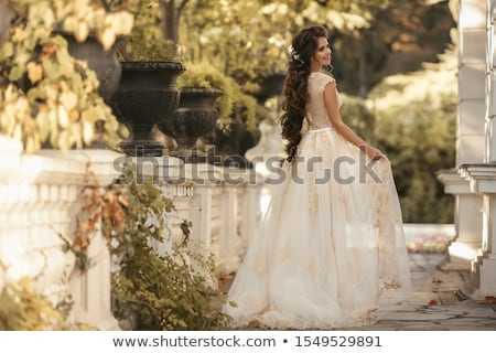 wedding portrait of gorgeous bride with long wavy hair wearing i stock photo © victoria_andreas
