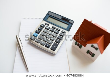 close up of home model, house keys and notebook Stock photo © dolgachov