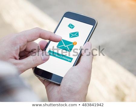 kéz · tart · mobil · okostelefon · üzenet · ikon - stock fotó © Customdesigner
