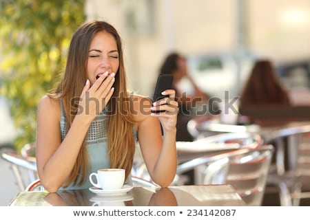 young adult woman yawning outdoors in the morning stock photo © stevanovicigor