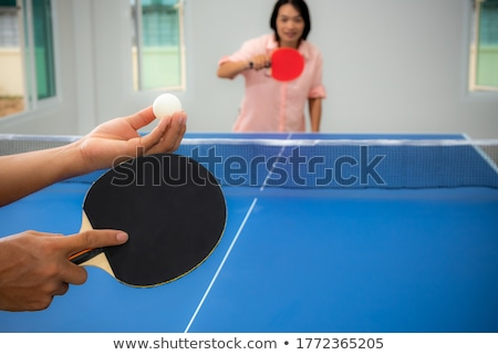 A female Asian playing tabletennis Stock photo © bluering