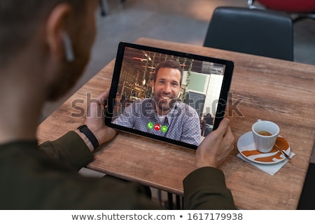 back view of smiling business man with phone stock photo © deandrobot