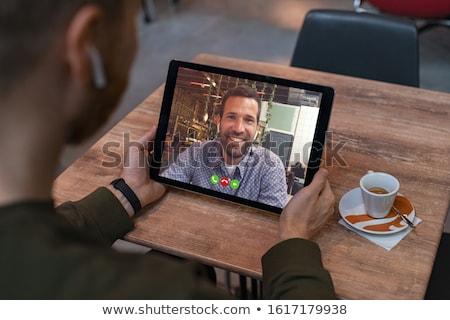 Ver de volta sorridente homem de negócios telefone terno ao ar livre Foto stock © deandrobot