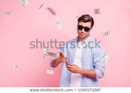 portrait of a young man in checkered shirt and glasses stock photo © feedough