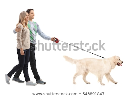 Young blonde girl with a dog on a walk Stock photo © konradbak