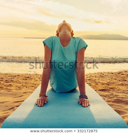 Mujer de la aptitud estera de yoga naturaleza puesta de sol hermosa encajar Foto stock © NicoletaIonescu