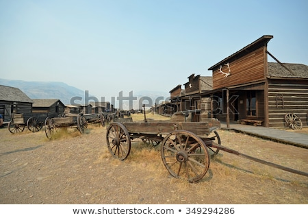 Western town scene with wooden wagon Stock photo © bluering