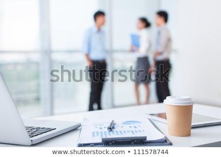 üzleti · csapat · dolgozik · táblagép · iroda · mosolyog · üzlet - stock fotó © dolgachov