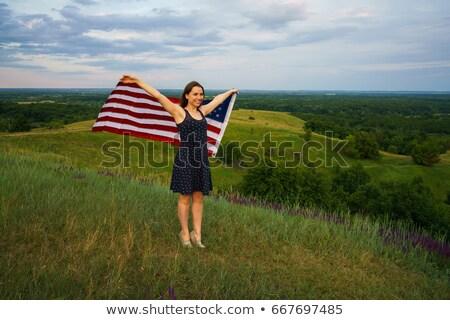 誇りに思う 女性 フラグ 立って 先頭 丘 ストックフォト © vlad_star